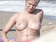 Just another hot topless lady at the beach.